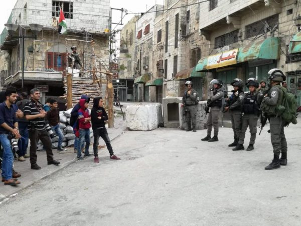 Israeli Border Police occupy the area around the Shuhada Street checkpoint. The concrete barrier was also moved further up the road recenty by Israeli forces, extending their control in H1.